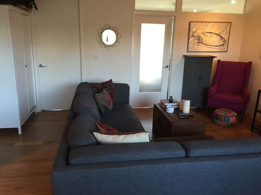 Living room with doors to the two bedrooms.