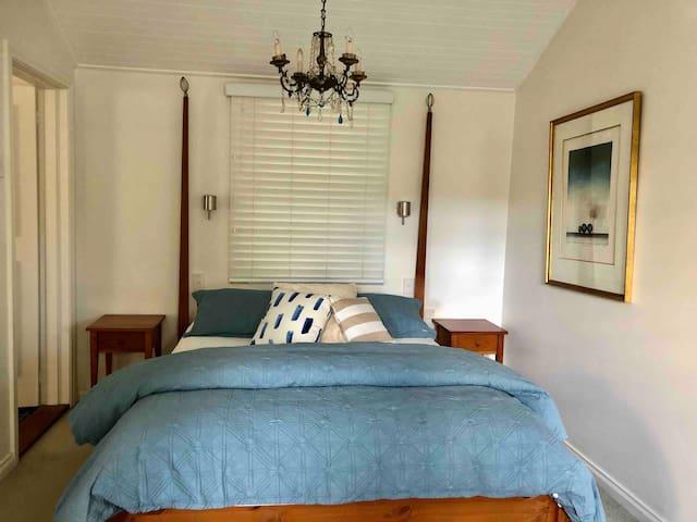 Light & bright queen bedroom