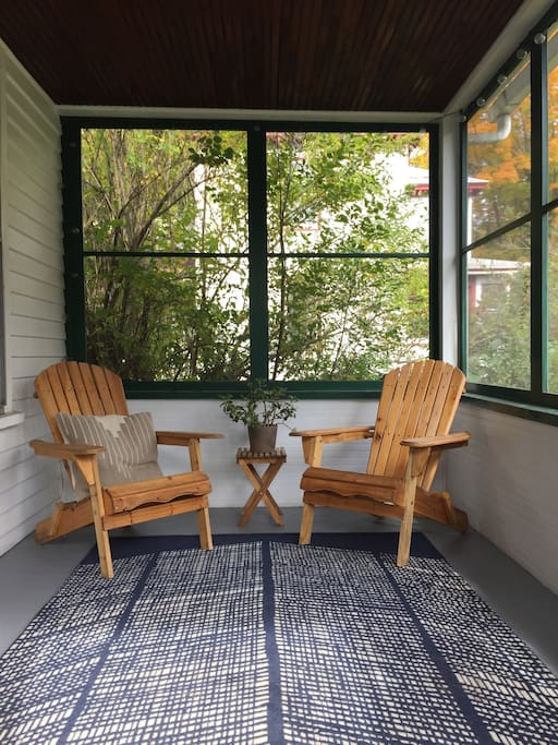 Sweet screened in porch with seating