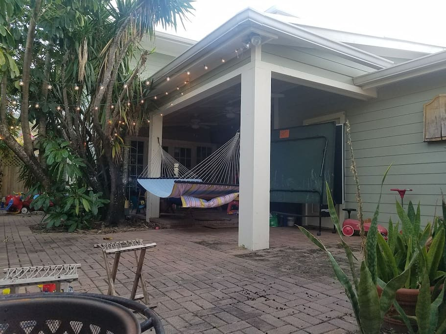 Spacious back yard with hammock, T.V, ping pong table, fire pit, dartes, picnic bench and small children's playground.