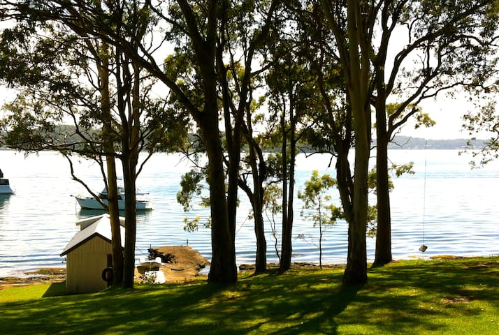 The boatshed and jetty and view from the house