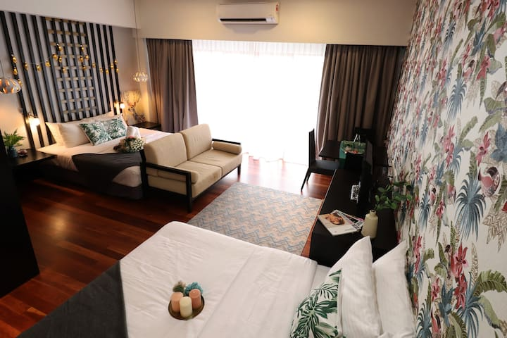 Welcome to CloudHost Home Stay – A Full view of our studio suite with 1 King size bed & 1 Queen size bed.