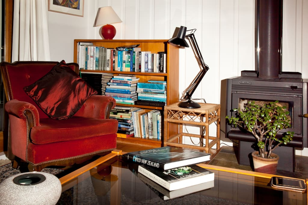 Small library of NZ and other books,  and the fantastic wood burner for Winter guests! (wood provided)