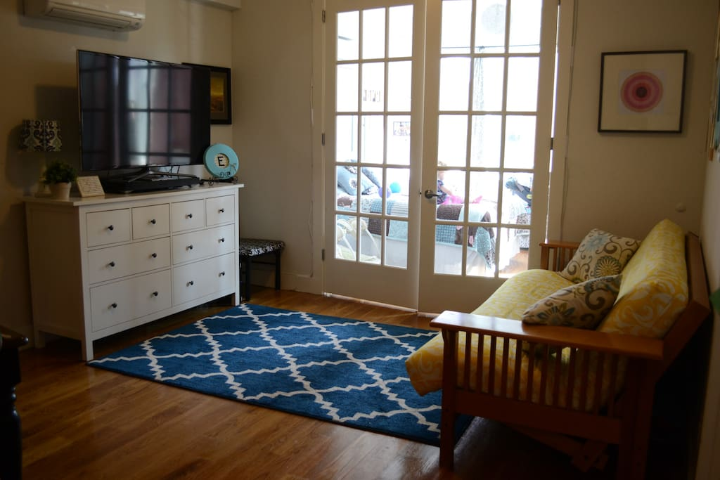 Open living room with futon bed/couch.