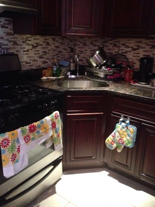 Small clean kitchen with all cooking essentials