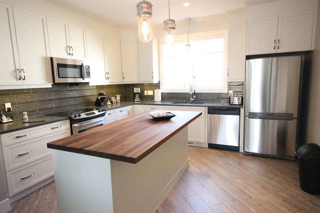 Fantastic kitchen with walnut kitchen countertop and upgraded stainless steel appliances