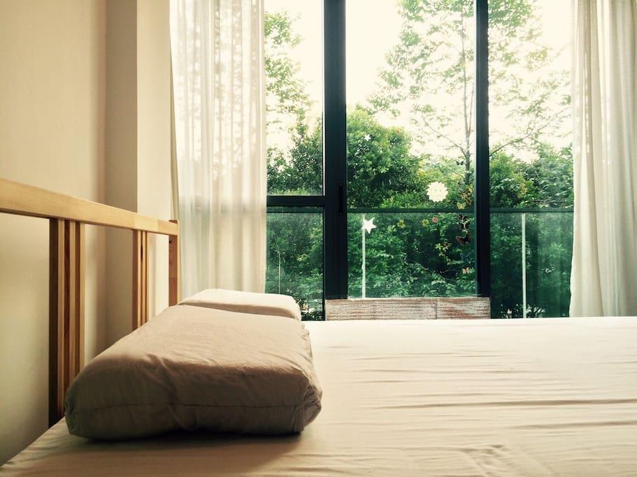 Bedroom. The glass door can be slided