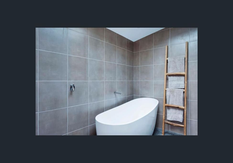 Bathroom - has beautiful tiling, a hot tub and a hot powerful shower