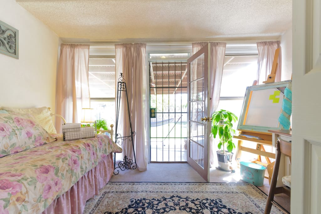 Direct access to the back yard from your room. A folding door separates your room from the living room.