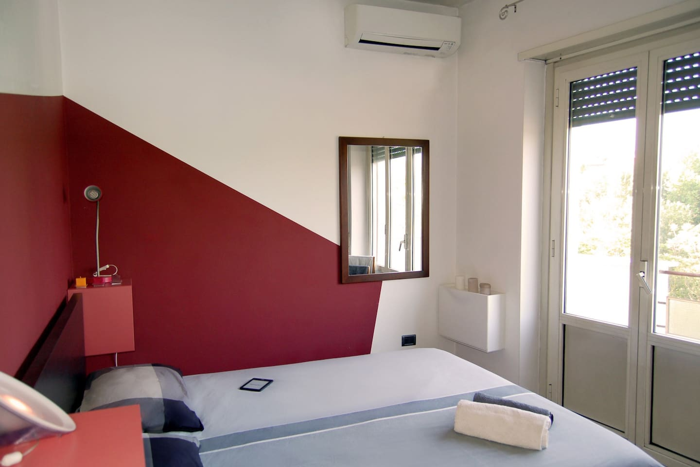 Bedroom with air conditioning and deck