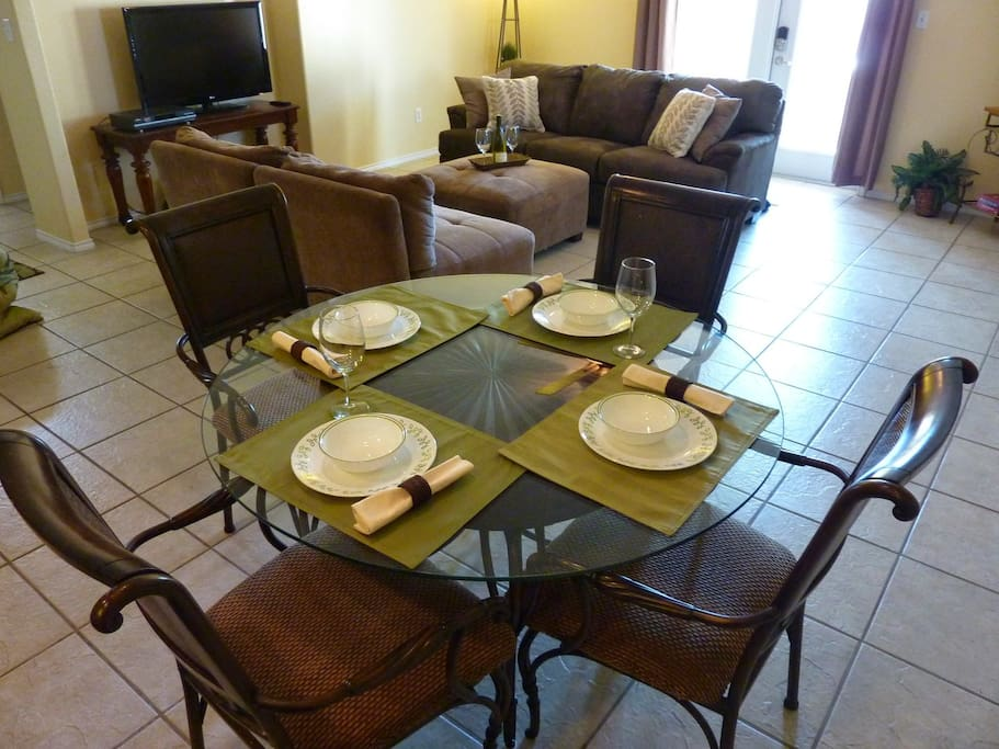 4-person dining table. Complimentary Wi-Fi is provided throughout the condo.