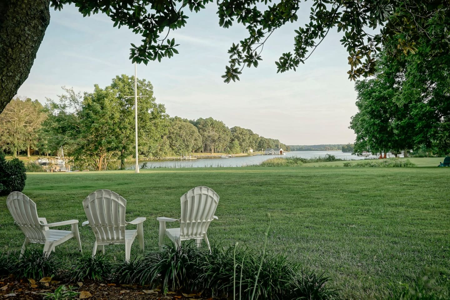 Serenity at Combsberry - just imagine sitting here looking out over the tranquil water scene with a cocktail in hand!