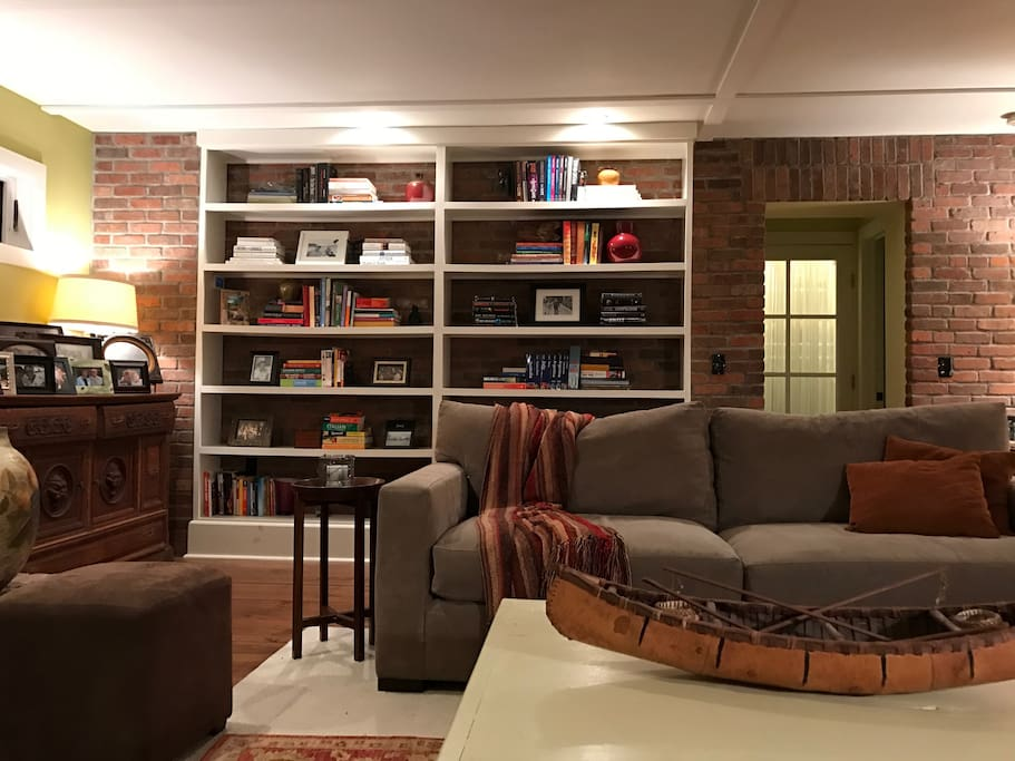Bookcase adding ambience to brick wall