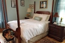 Pristine white down comforter & sheets for cozy winter time sleeping.