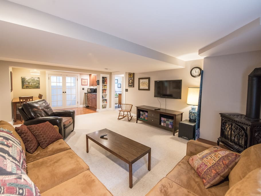 Open floor plan is convenient for watching tv or movies, eating or working at the dining room table. French doors are the end of the apartment.  They let in a lot of light.