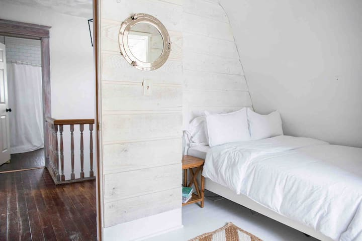 Bedroom 3 - A cozy shiplap lined room with 1 full sized bed.