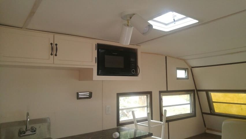 The RV includes a microwave,