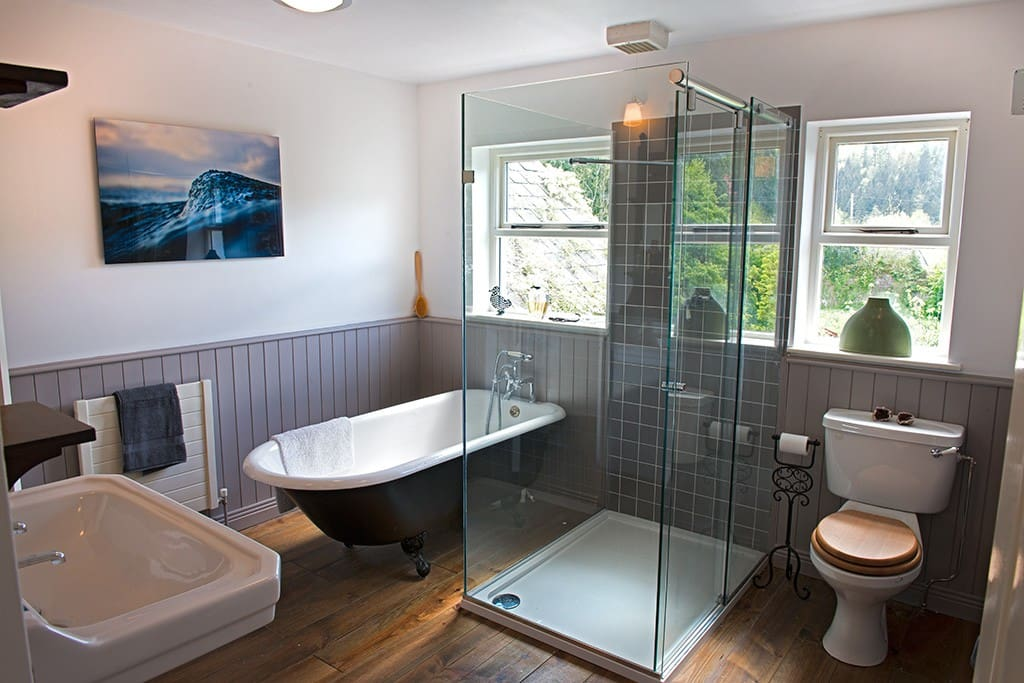 New sizeable bathroom with large bath and powerful shower.