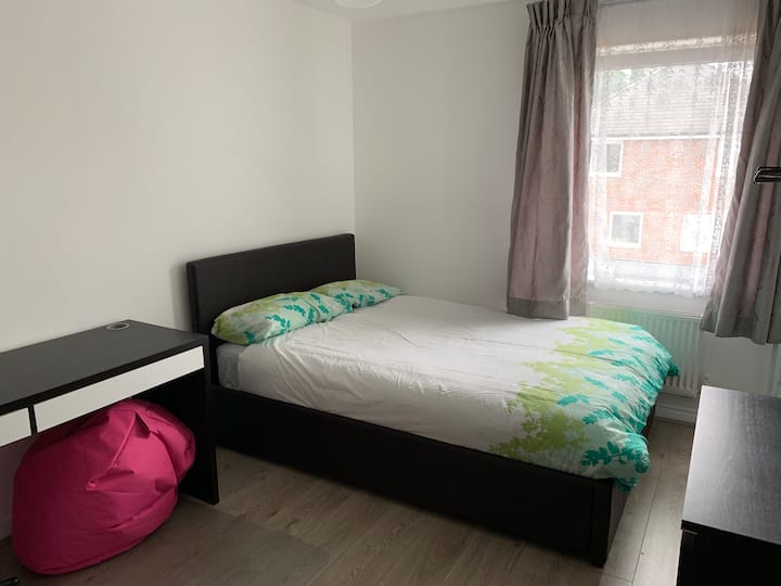 Bright double room with study desk and comfy chair