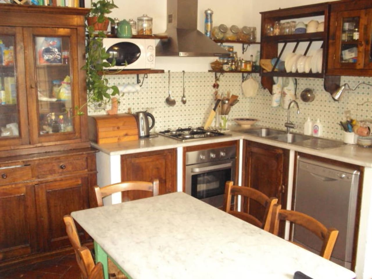 Kitchen -- typical Tuscan style (in muratura) with restaured original furniture