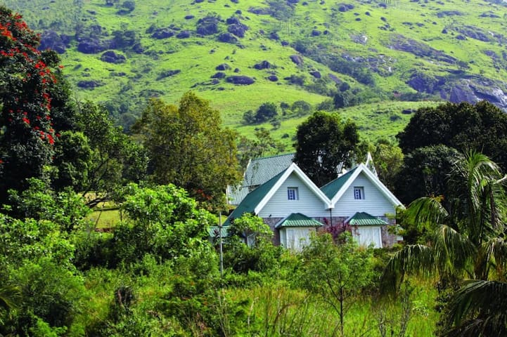 Colonial Cottage in an organic plantation @ Munnar