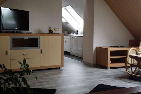 DG-Wohnung im Mehrfamilienhaus - Garbsen - Hus