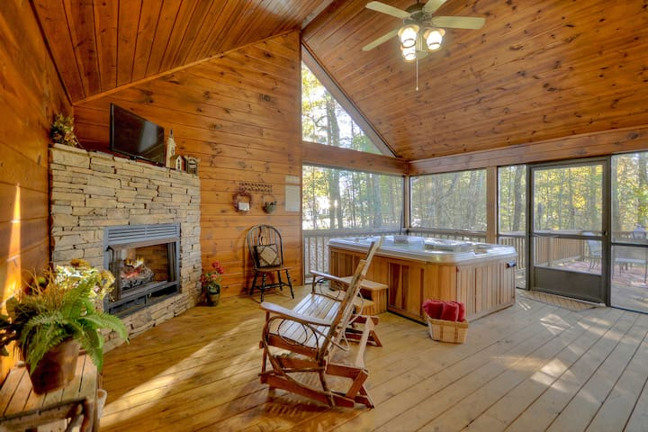 Screened in Porch   Complete with outdoor gas fireplace, TV, and hot tub