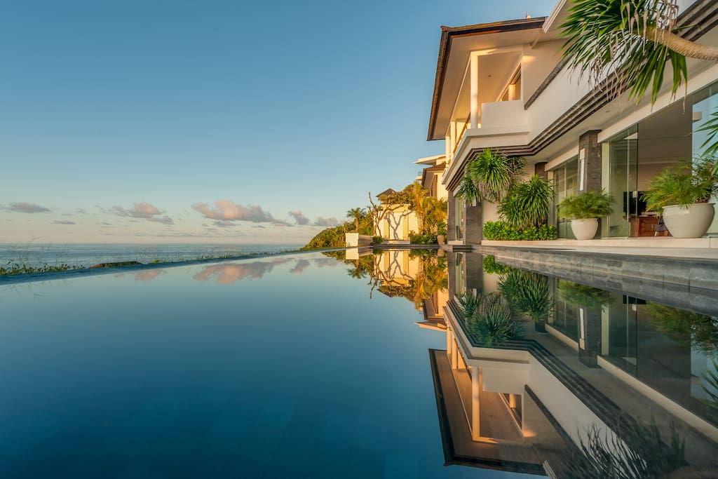 Smooth as glass infinity edge pool during sunrise.