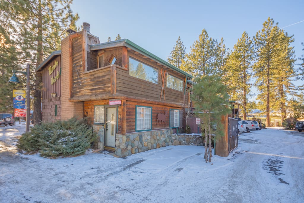 You'll be surrounded by tall pine trees and just across the street from a great coffee shop.