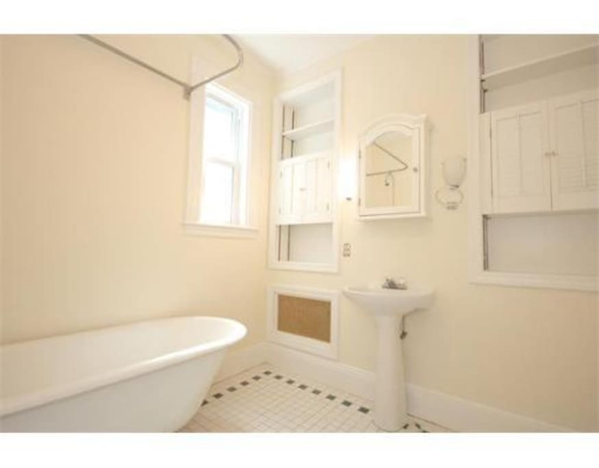 Full bathroom with charming claw foot tub