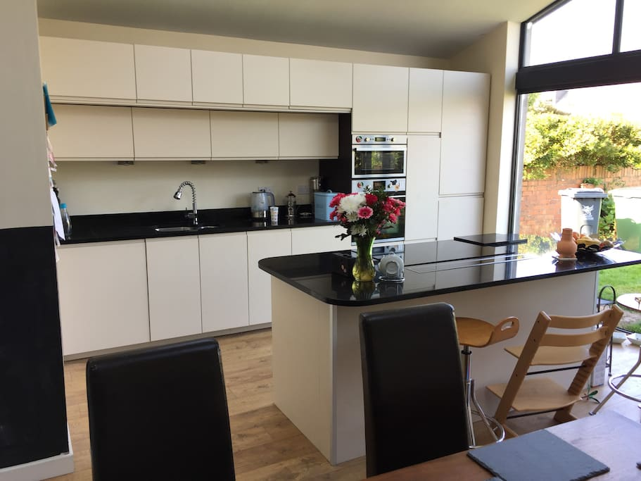 New large space kitchen with induction hob, with full access to large garden