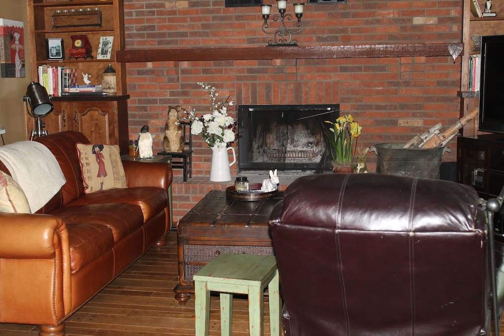 family room with leather couch and chair