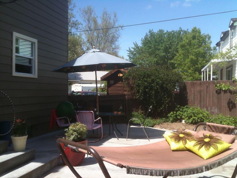 Where we eat from an organic garden, enjoy the sunshine, a little music, glass of vino & relax.