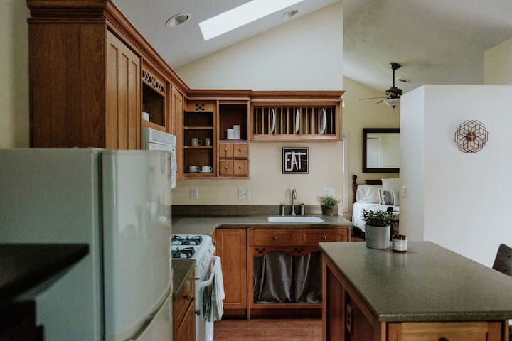 Kitchen features vaulted ceiling and skylight.  In addition to a gas range/oven, it includes a microwave, fridge, Keurig machine, dishes, utensils, pots & pans--stay awhile!