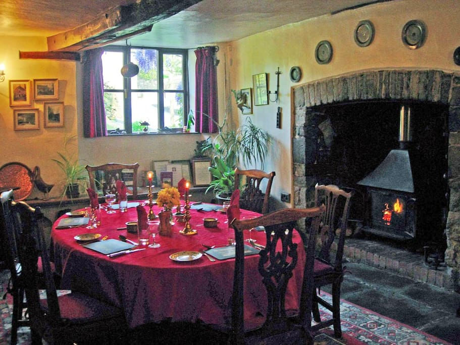 Breakfast in the medieval dining room next to the crackling log fire