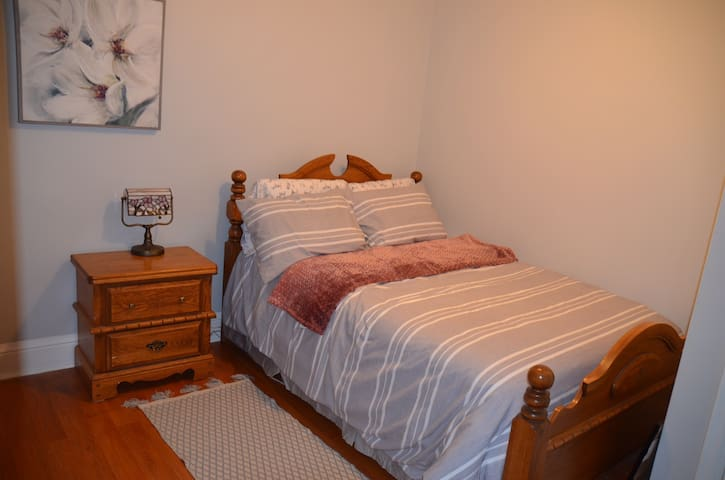 This bedroom has a double bed and a closet.