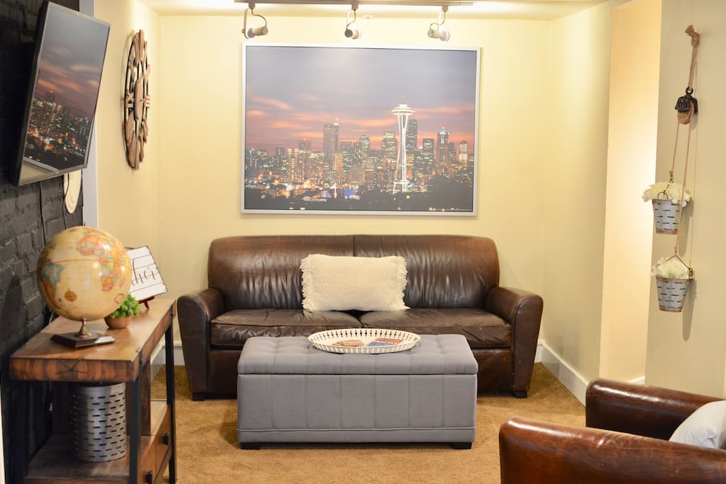 Living Room with TV, Leather Couch and Chair