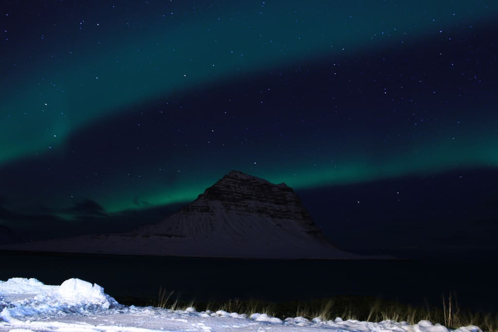 Northern lights over Kirkjufell. Picture taken from our parking lot.