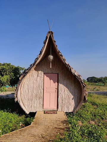 Bamboo Teardrop Hut with queen size mattress and sunrise views out the back windows