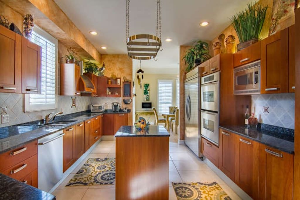 Kitchen designed for entertaining and cooking. Everything you need to serve a large group of friends and family provided.