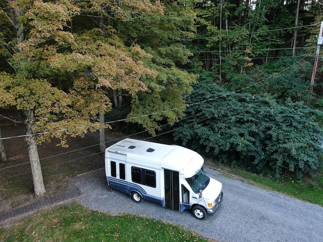 Shuttle Bus converted into Charming Tiny Home