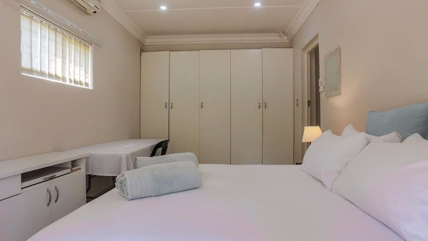 Main bedroom with ample closet space. Airconditioned
