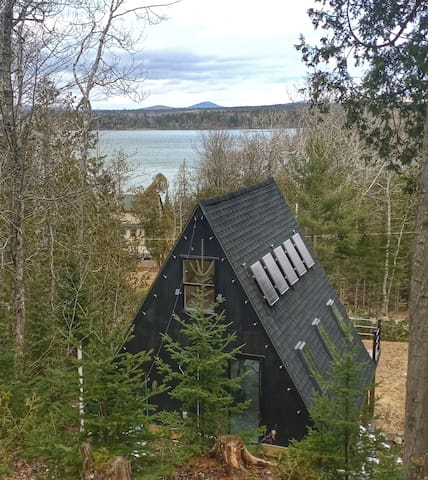 A-FRAME cabin with kayak overlooking the bay.