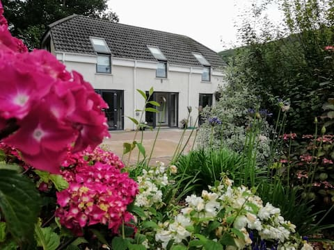 Garth Bach set in 2 acres of gardens