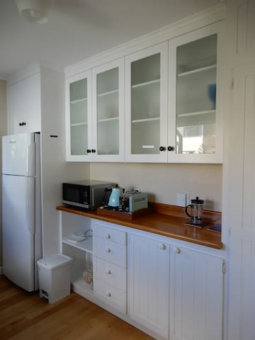 Kitchen includes fridge/freezer, microwave, jug, toaster, coffee plunger and toastie maker.