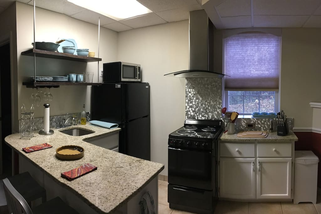 A full kitchen with island for dining. Compact range, full size refrigerator, & microwave and everything you need to make dining in an option to eating out every night. if it's not there I'll try to get it for you.