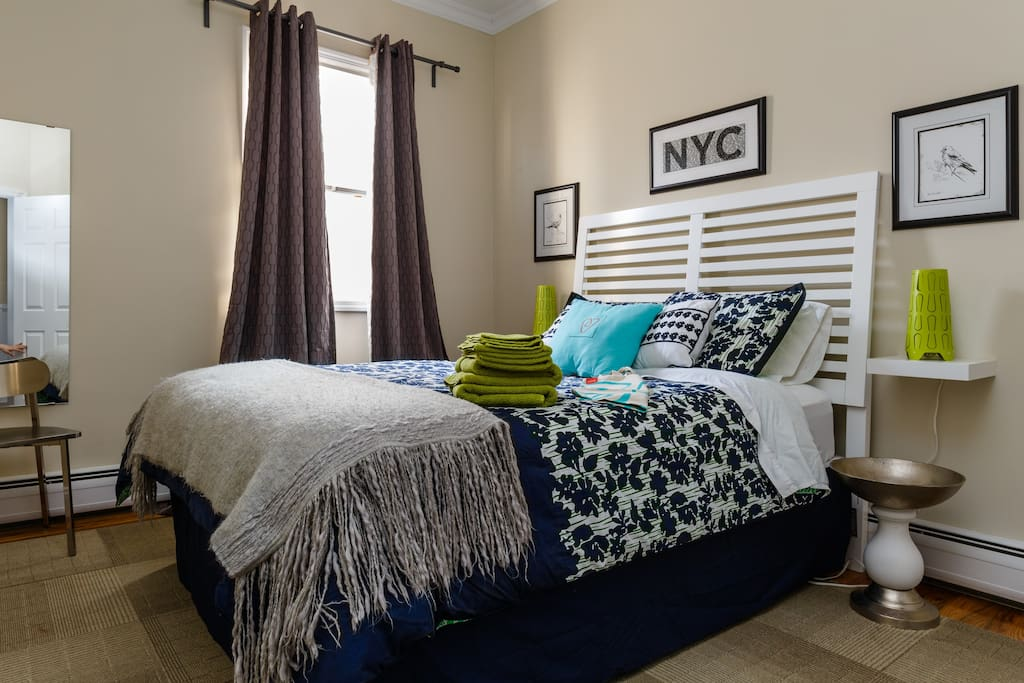 Large bright bedroom with queen bed