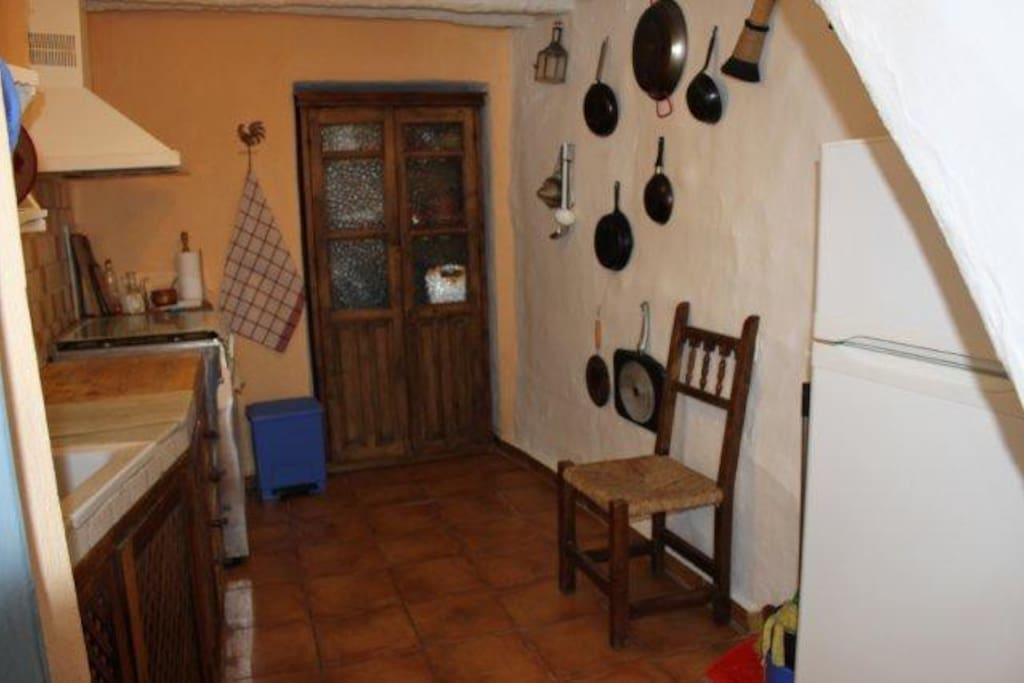 Kitchen, refrigerator, gas stove (uses gas cannister) food cabinet