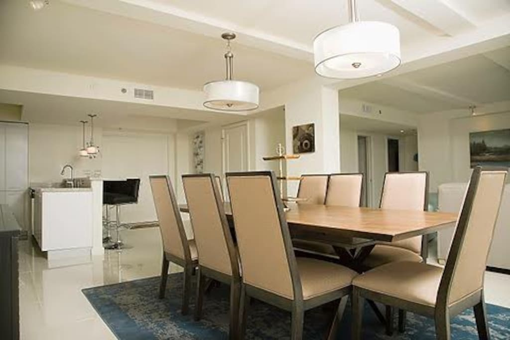 The dinning area offers a lavish table set that accommodates eight with a great view of the bay area.