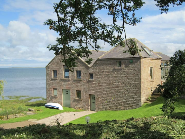 Fenham Mill on Lindisfarne Bay. Stunning sea views
